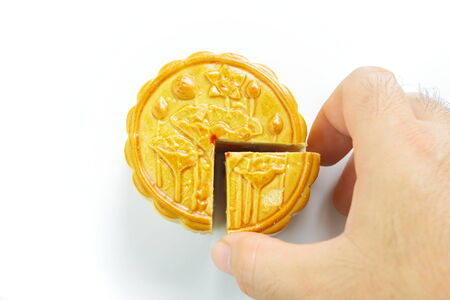 cake pick: Moon cake and hand is picking