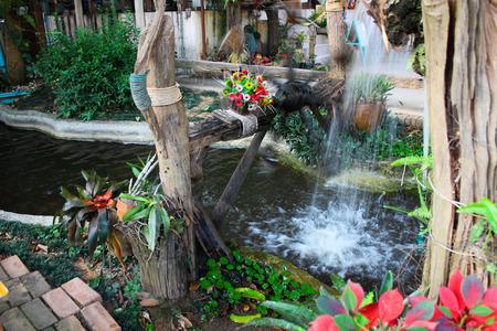 waterwheel: Waterwheel and pond in relax garden Stock Photo
