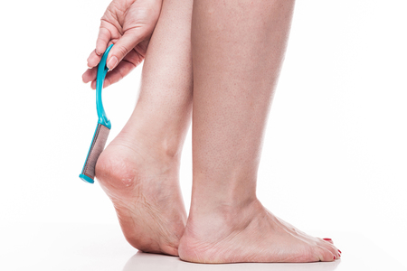 callus: care for dry skin on the well-groomed feet and heels with the help of tools pedicure graters Foot.