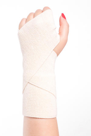 studio shot female wrists tied with an elastic bandage. Stock Photo