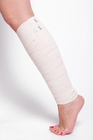 sprained joint: ankle woman dragged elastic bandage.