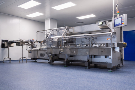 production area: photos sterile production area with stainless steel machine for the production and sorting of pills and medicines