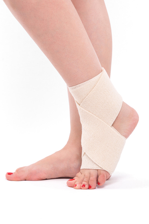 womens leg tied with an elastic bandage, ankle foot. Stock Photo