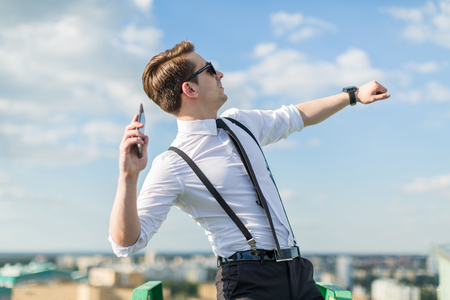 young man throwing phone
