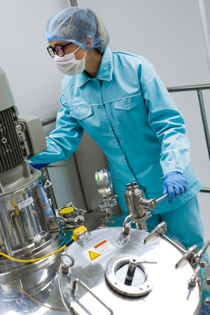 obtaining: Scientists working with large vat in the lab Stock Photo