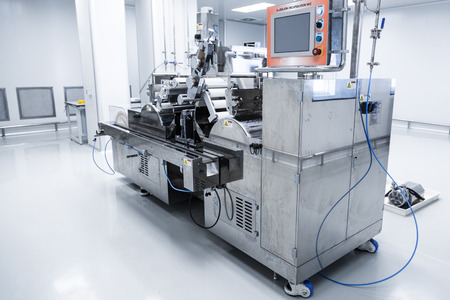 manufacture steel machine with control computer in clear room Stock Photo