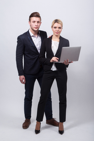 two businessmen the man and woman with a laptop in hand on a white background.