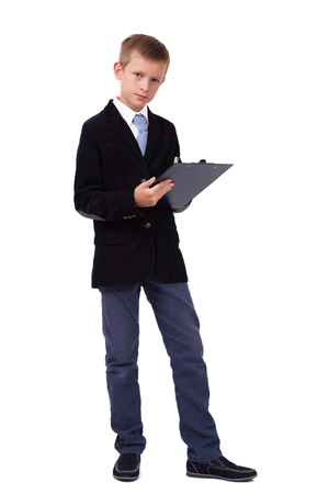 student in a business suit on a white background taking notes in tablet, picture with depth of field and artistic blur