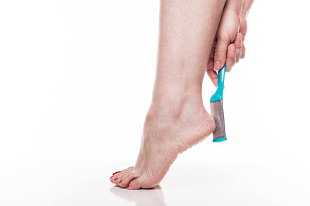 care for dry skin on the well-groomed feet and heels with the help of tools pedicure graters Foot.
