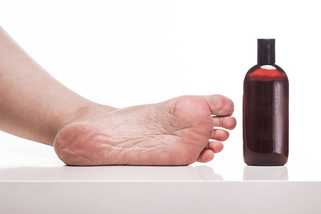care for dry skin on the well-groomed feet and heels with creams for the skin and feet.
