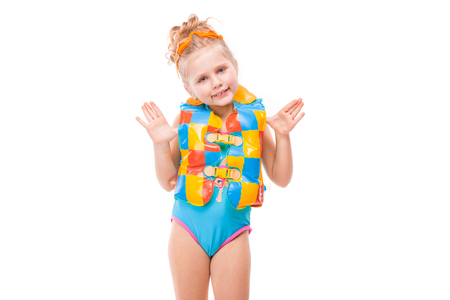 5aed3502eb Isolated on white, pretty little caucasian blonde girl in blue swimming  suit and colorful life