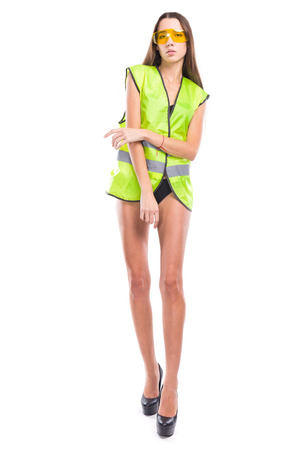 young sexy woman in builder outfit and black bikini, crossed hand Foto de archivo