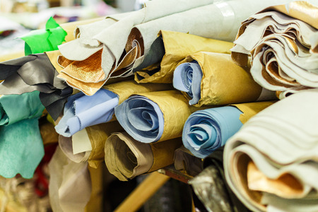 Rolls Of Fabric Wrapped In Craft Paper Lying On Each Other