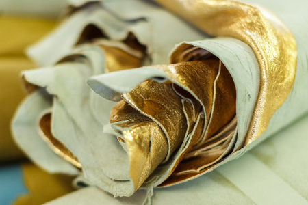 roll of gold colored material. close-up photo