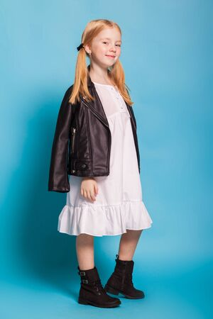 a pretty little girl in the white dress and black shoes with sunglases Banco de Imagens - 91381516