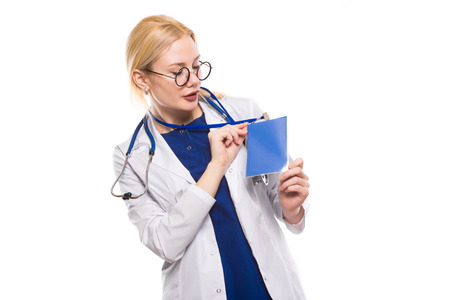 Portrait of female doctor in white coat with stethoscope and glasses shows blank badge ID card or pass isolated on white background with copyspace medical conference or seminar concept.