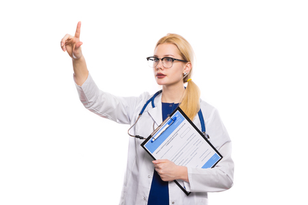 Female doctor in white coat and glasses with stethoscope hold clip pad with medical record application form examine something carefully with her finger up isolated on white background with copyspace.