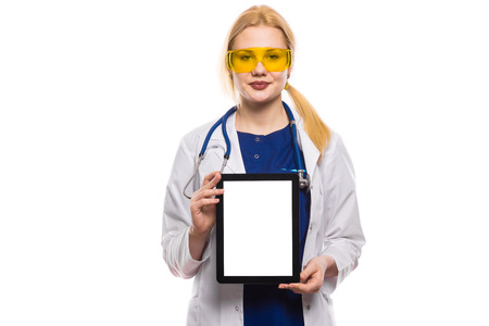 Portrait of female doctor in white coat wear stethoscope and yellow glasses isolated on white background with copyspace hold digital tablet computer medical technology network concept.