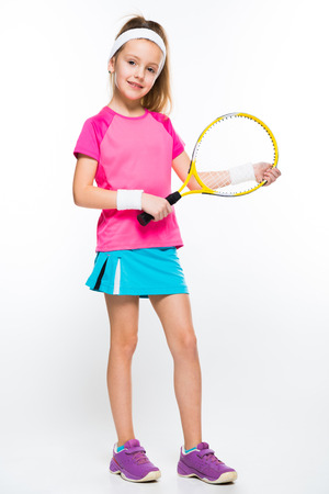 Adorable smiling little girl in sportswear holding tennis racket in her hands on white background brunette caucasian beautiful attractive friendly isolated Banque d'images