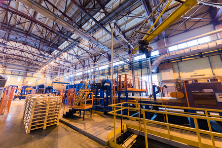 Modern operational plant with stocks of pallets heavy industry machinery metalworking workshop concept.