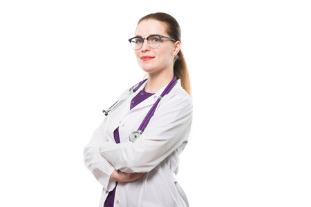 Beautiful happy cheerful woman doctor looking in camera waiting for a patient confident successful smiling with stethoscope with arms crossed