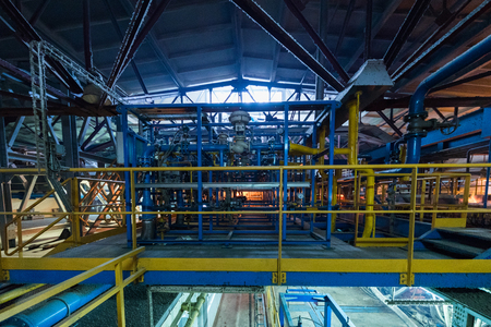 Factory workshop interior and machines on glass production background Stock Photo