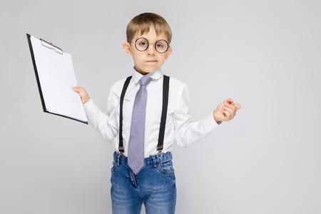 Portrait of a boy on a gray background