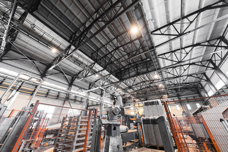 Modern operational plant equipment producing fiberglass with pallets on background heavy industry machinery metalworking workshop concept.