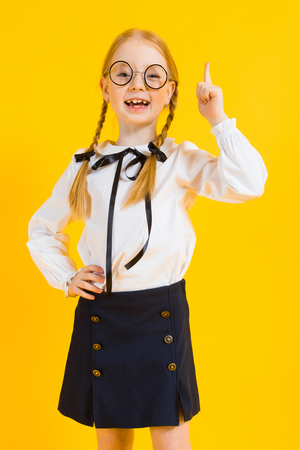 Portrait of a beautiful girl in a white blouse and black skirt. Foto de archivo