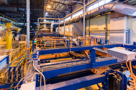 Factory workshop interior and machines on glass industry background 版權商用圖片