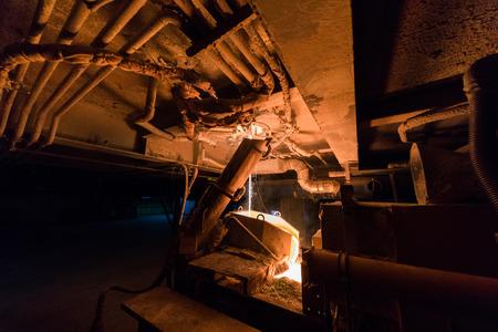 Steel production in electric furnace heavy industry machinery metalworking workshop concept. Standard-Bild - 102594665
