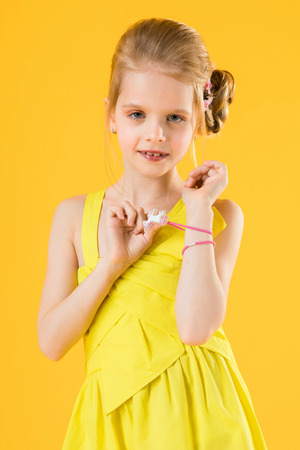 Portrait of a teenage girl in a yellow dress.