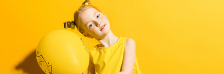 Portrait of a beautiful girl in a yellow blouse and blue jeans. Imagens