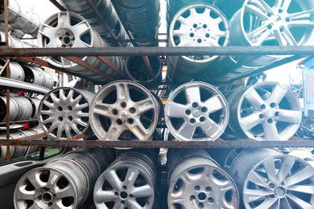 Everything for car repairs. Stacks of car rims.