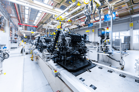 internal structure of car. Modern automobile production line, automated production equipment. Shop for Assembly of new modern cars. way of Assembly of the car on Assembly line at plant