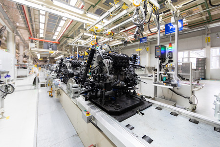 Automated Assembly line of car mechanics. Automobile industry plant Stock Photo - 117634072