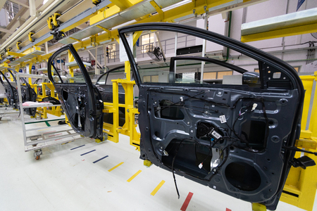 Automated car Assembly line. Assembly of car door. plant of automotive industry. Line of car body Stock fotó