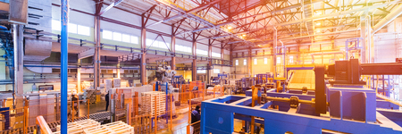 Modern operational plant equipment producing fiberglass heavy industry machinery metalworking workshop concept.