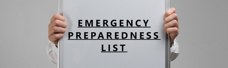 Emergency preparedness list in the hands in a white shirt. Handwriting text writing Emergency preparation and Response Adviser. Concept meaning Be prepared for emergencies 版權商用圖片