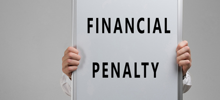 hands in a light shirt with a poster with an inscription about financial penalty isolated in a light Studio. Documents about Financial penalty. Form with a fine. insurance policy. place for a label