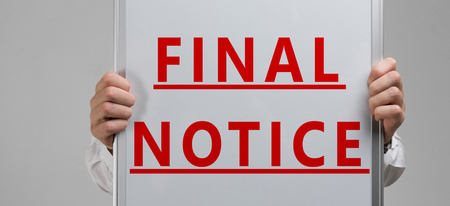 hands in a shirt with a poster with a red inscription about final notice isolated in a bright Studio. Holding Invoice With Final Demand Notification. FINAL EXAM message on the card shown by a man