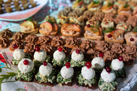 close-up of a variety of snacks are on the table in the restaurant. bright mouth-watering food. Delicacies and snacks in the buffet. A gala reception. Banquet. Catering