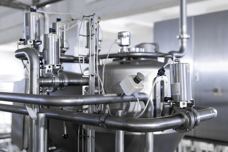 Modern interior of factory with production process background Imagens