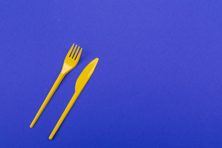 Disposable set of vibrant tableware isolated on background. Mock-up