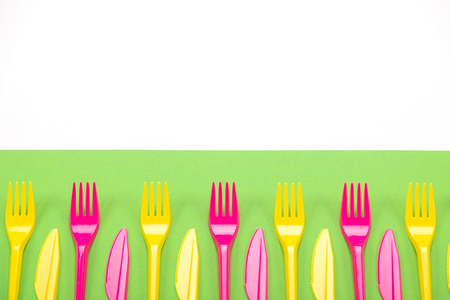 Composition of colorful plastic cutlery on a bright background mock-up Reklamní fotografie