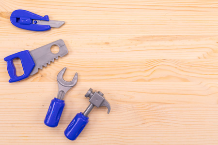 Plastic set of joiners tools spread out on wodenl background Standard-Bild