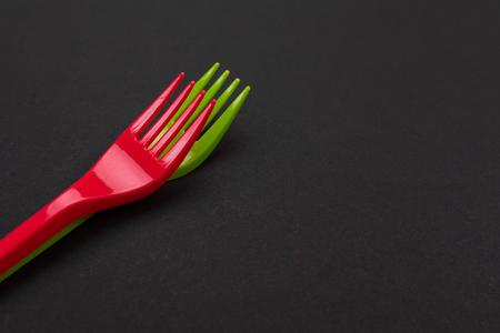 Top view of red and green plastic forks. Mock-up Reklamní fotografie