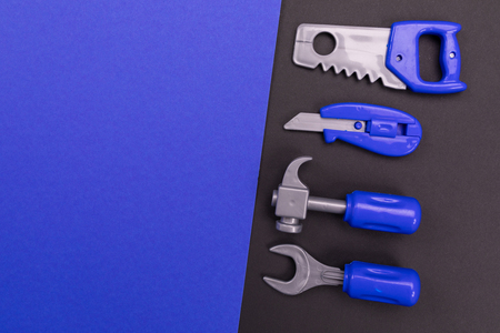 Plastic set of joiners tools spread out on colorful background