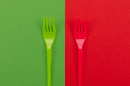 Bright green and red forks atop of red and green background. Mock-up