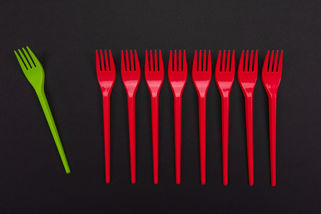 Plastic set of red and gereen forks on background. Mock-up